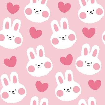 心でかわいいウサギのシームレスパターン