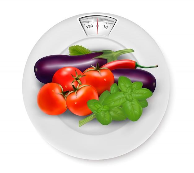 野菜入りのはかり。ダイエットのコンセプトです。