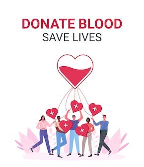 ボランティアの女性と男性が献血をしています。