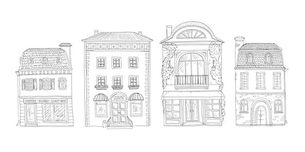 ヴィンテージのヨーロッパの家のスケッチ図の黒と白のセット。旧市街の建物のショップやカフェ。