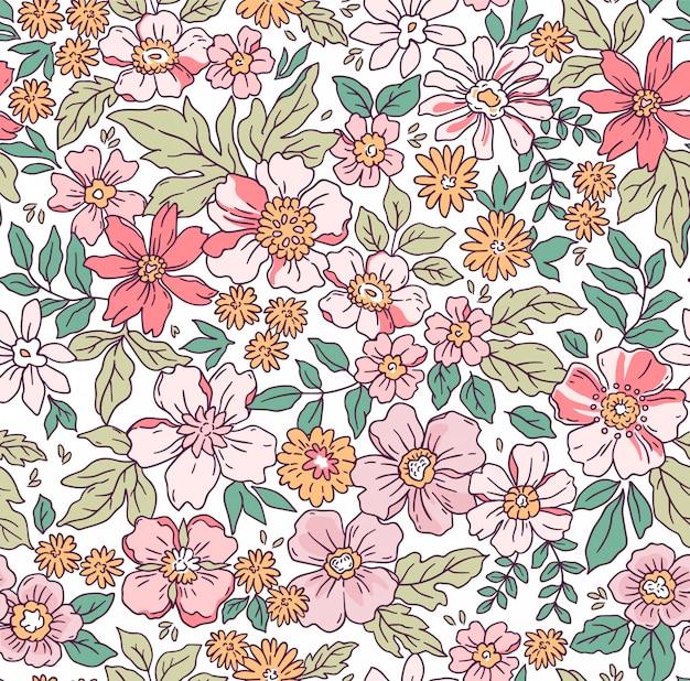 手で花柄は小さな花を描きます。リバティスタイル。ファッションプリントのための花のシームレスな背景。リバティスタイル。春の花束。