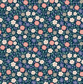 小さな花でかわいい花柄。頭が変なプリント。シームレスなベクトルの背景。ファッションプリントのエレガントなテンプレートです。