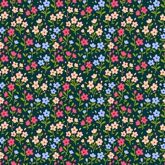 小さな花でかわいい花柄。頭が変なプリント。シームレスなベクターテクスチャ