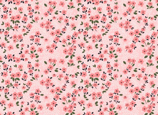 小さな花でかわいい花柄。頭が変なプリント。シームレスなベクトルの背景。