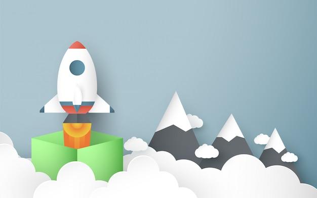 Иллюстрация с запуском концепции в стиле бумаги вырезать, ремесло и оригами. ракета летит на голубое небо.