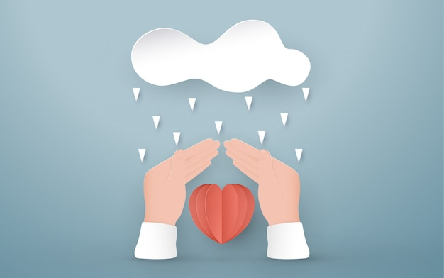 Руки защищают красное сердце.