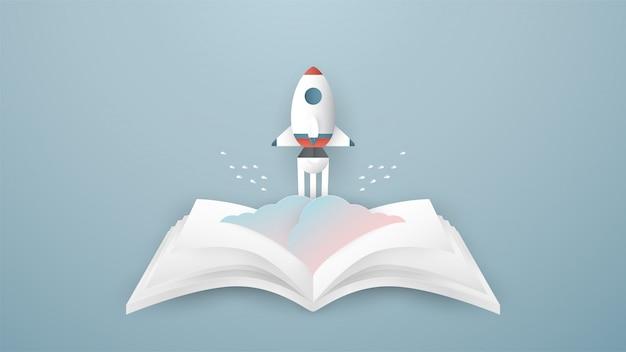 Ракета поднимается из раскрытой книги.
