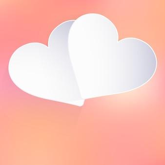 紙のハートの形でバレンタインデーの背景。