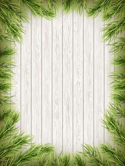 クリスマスのモミの木と木製の背景。