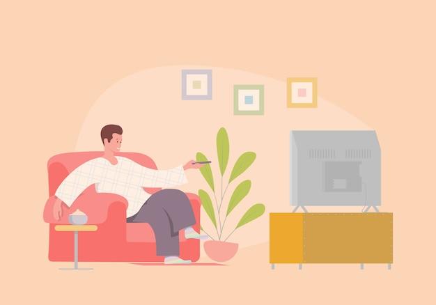 肘掛け椅子でテレビを見ている男の図。