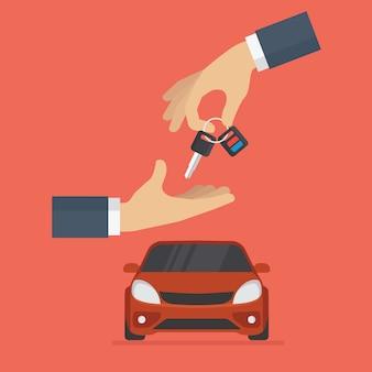 Автодилер вручает ключи от машины покупателю