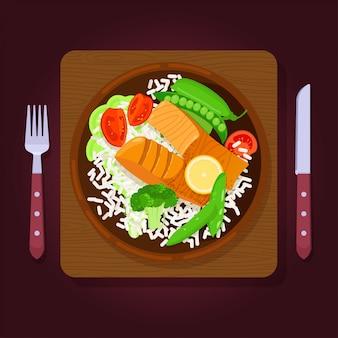 サーモンのグリルステーキとライスと野菜