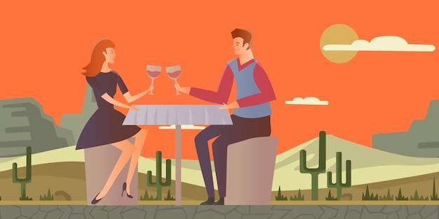 愛のカップル。砂漠の風景の中のロマンチックなデートの若い男女。