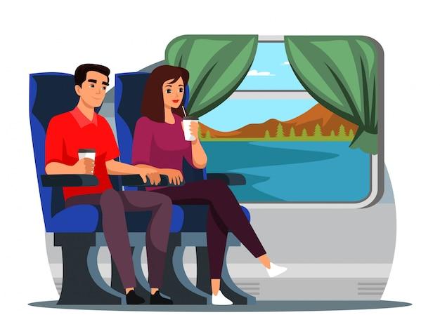 コーヒーを飲みながら電車で旅行する人