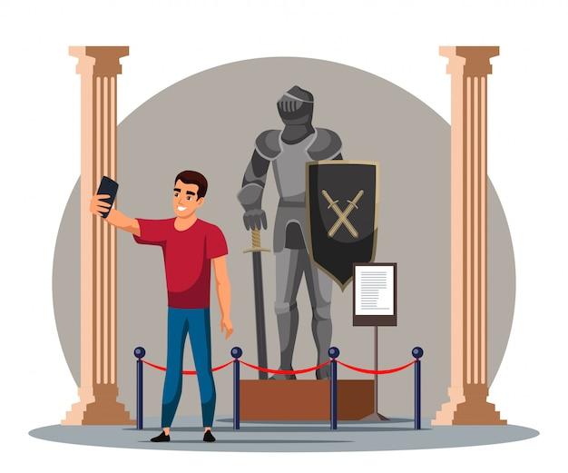 歴史博物館で騎士と一緒にセルフィーを取る男