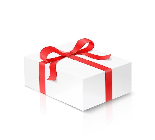 赤い色の弓の結び目と白い背景の上のリボンのギフト携帯電話ボックス。お誕生日おめでとう、クリスマス、新年、結婚式やバレンタインのパッケージコンセプト。拡大図表示