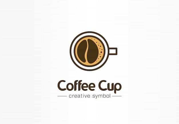 豆の形の泡の創造的なシンボルのコンセプトとコーヒーカップのトップビュー。カフェメニュー、レストランの抽象的なビジネスのロゴのアイデア。新鮮なエスプレッソアイコン