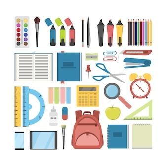 学校の文房具セット。ペンと定規、本とバックパック。