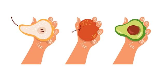 手は、孤立した背景に果物を保持しています。健康的な朝食。適切な栄養、ビーガン。エコ製品。