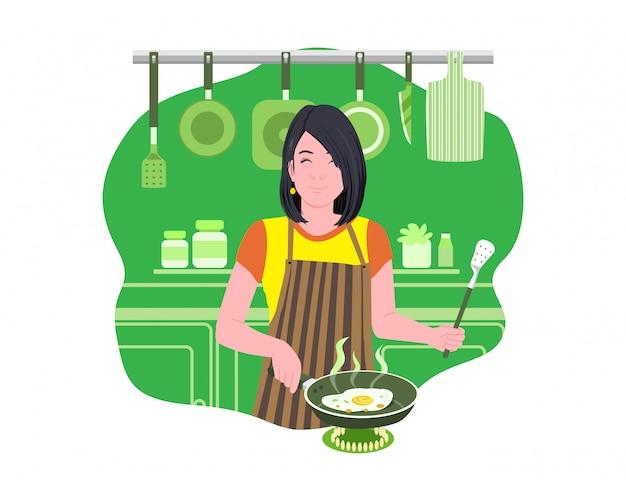 ママは朝食に卵を調理します。かわいい女の子は台所で料理をしています