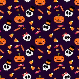 カラフルなハロウィーンのキャンディーと頭蓋骨のシームレスなパターン。