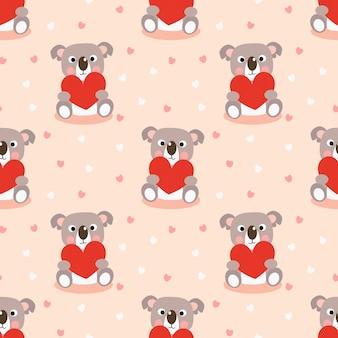 かわいいコアラと赤いハートのシームレスパターン。
