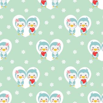 心と雪のシームレスパターンでかわいいカップルペンギン。