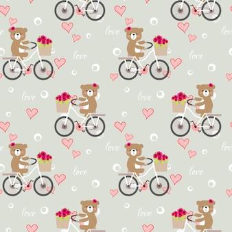 かわいいクマのシームレスパターンは、バレンタインの背景で自転車に乗る。