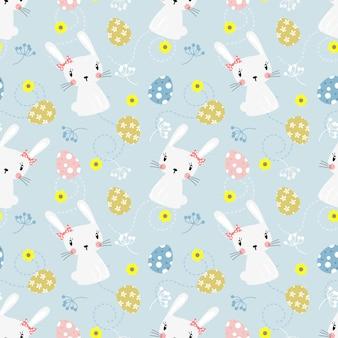 かわいい白ウサギとイースターエッグのシームレスパターン。