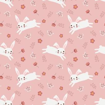 かわいい白ウサギと花のシームレスパターン。