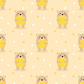 かわいいクマは大きなレモンのシームレスなパターンを保持します。