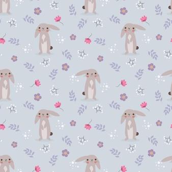 かわいいウサギと花のシームレスパターン。
