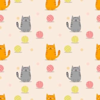 かわいい猫と糸のボールのシームレスパターン。