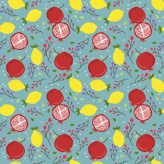 新鮮なレモンとザクロのシームレスパターン。