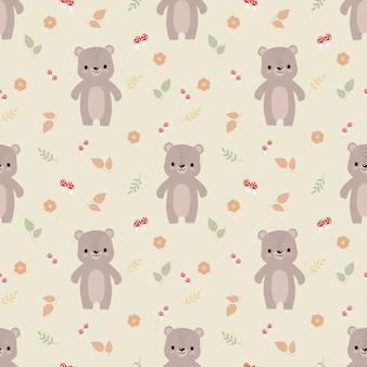 かわいいクマと秋の葉のシームレスなパターン。