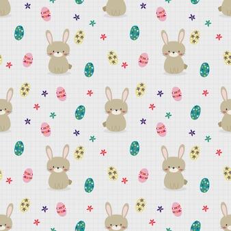 かわいいウサギとイースターエッグのシームレスなパターン。