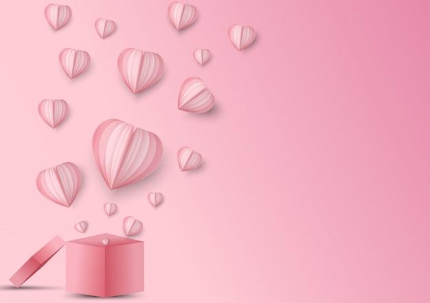 バレンタインハートとギフトボックス。折り紙は、ギフトボックスから飛んで紙の心を作った