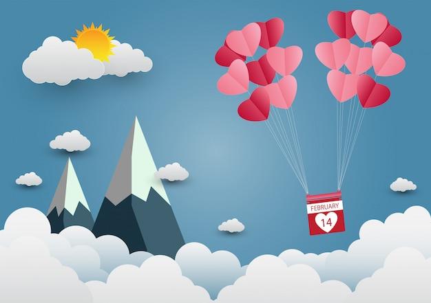 空に浮かぶハート型の風船と美しい山々