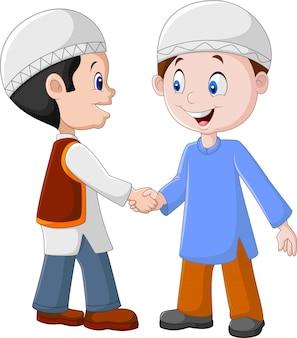 手を振っている漫画イスラム教徒の少年