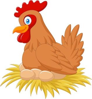 巣の中の漫画の鶏が卵を繁殖させる