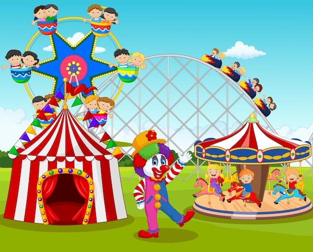 カーニバルフェスティバルの小さな子供とピエロの漫画