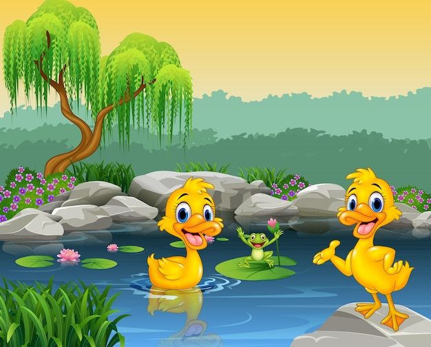 池とカエルで泳ぐかわいいアヒル