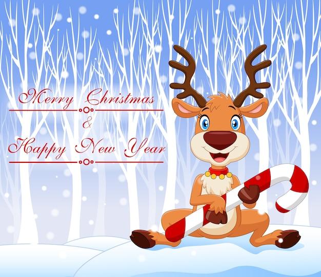クリスマスキャンデーを持つ漫画の面白い赤ちゃんの鹿
