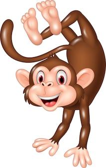 白い背景に漫画の幸せな猿の踊り