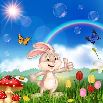 漫画かわいい小さなウサギは、親指を与える
