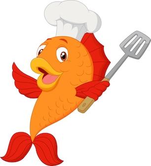 スパチュラを保持する漫画シェフの魚