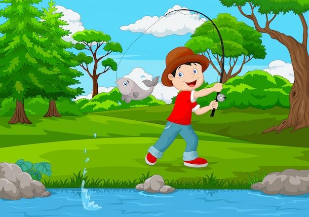 小さな男の子、湖の釣り