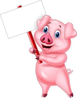 空白のサインを持っている漫画の豚