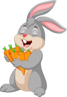 ニンジンを保持している漫画のウサギ
