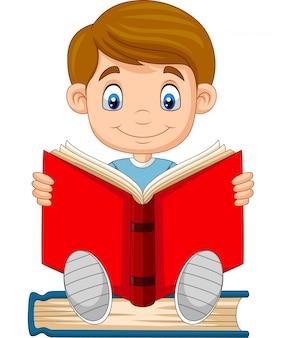 Мультяшный мальчик читает книгу